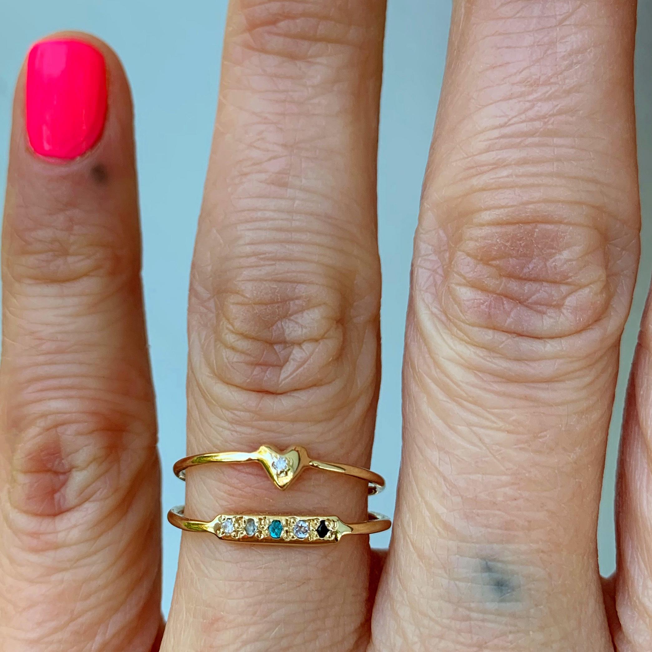 wearing the teeny tiny heart ring