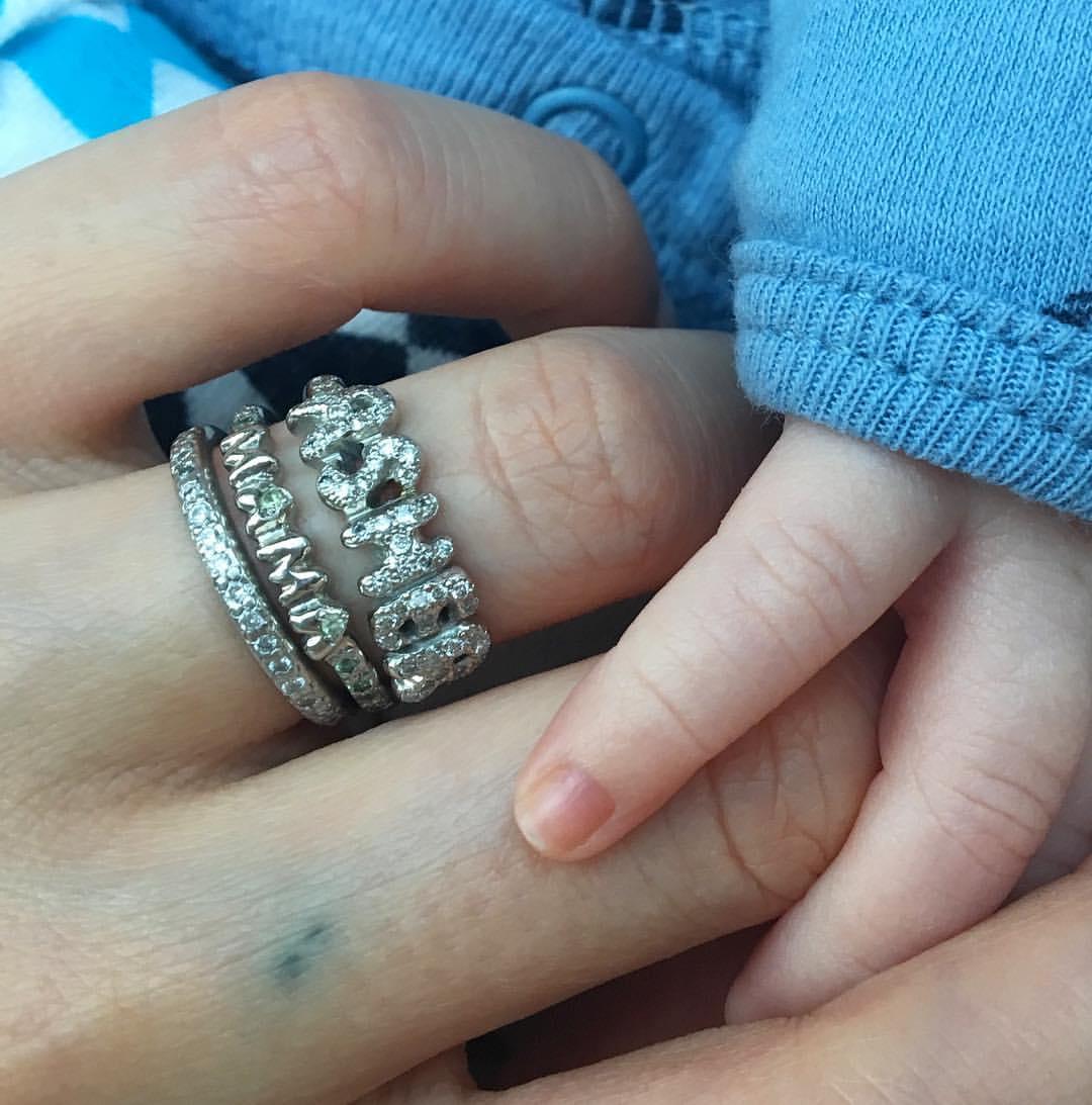 wearing platinum name ring with white diamonds